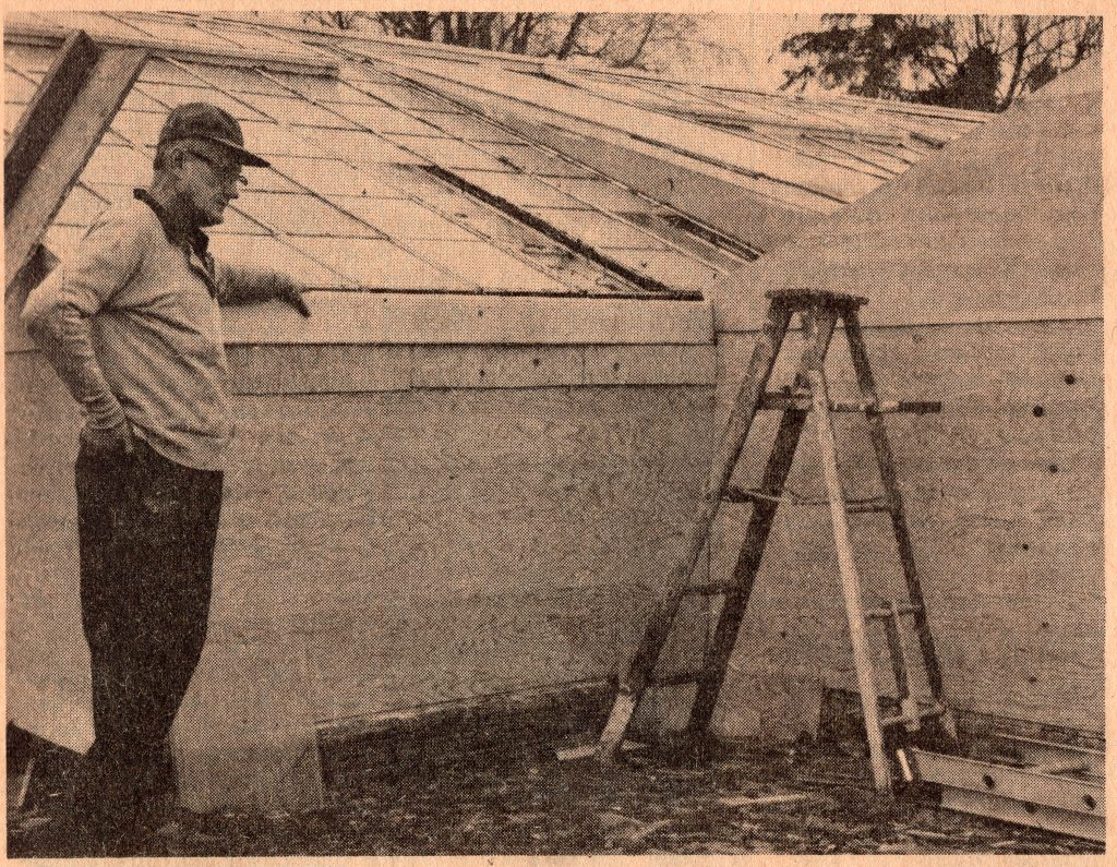 Carl Herrick, greenhouse owner and operator, stands feet away from where a stick of dynamite ripped through